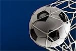 A soccer ball in a net, close-up Stock Photo - Premium Royalty-Free, Artist: CulturaRM, Code: 653-03575447