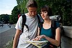 A young backpacker couple looking at a city map Stock Photo - Premium Royalty-Free, Artist: Bryan Reinhart, Code: 653-03575882