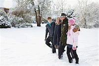 Grandparents walking in the snow with two grandchildren Stock Photo - Premium Royalty-Freenull, Code: 653-03576097
