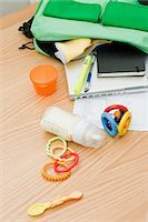 Baby and work equipment coming out of bag Stock Photo - Premium Royalty-Freenull, Code: 614-03577020