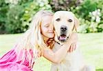 Girl hugging dog Stock Photo - Premium Royalty-Freenull, Code: 635-03577386