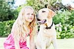 Girl in backyard with dog Stock Photo - Premium Royalty-Freenull, Code: 635-03577387