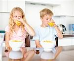 Children having breakfast of cereal and juice Stock Photo - Premium Royalty-Freenull, Code: 635-03577405
