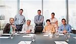 Smiling business people in conference room overlooking city Stock Photo - Premium Royalty-Freenull, Code: 635-03577662
