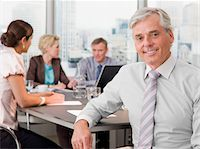 Smiling businessman in conference room Stock Photo - Premium Royalty-Freenull, Code: 635-03577726