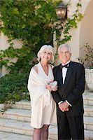 Well-dressed senior couple smiling Stock Photo - Premium Royalty-Freenull, Code: 635-03577912