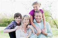 Smiling family hugging outdoors Stock Photo - Premium Royalty-Freenull, Code: 635-03578000