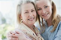Close up of smiling mother and daughter hugging Stock Photo - Premium Royalty-Freenull, Code: 635-03578125
