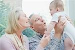 Grandparents playing with baby grandson Stock Photo - Premium Royalty-Freenull, Code: 635-03578131