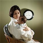 Tired Mother With Baby in the Middle of the Night Stock Photo - Premium Rights-Managed, Artist: Natasha Nicholson, Code: 700-03586283
