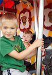 Boys on Merry-go-Round, Ontario, Canada Stock Photo - Premium Rights-Managed, Artist: Derek Shapton, Code: 700-03596234