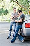 Teenage Boys Leaning Against Car, Using Cell Phones Stock Photo - Premium Rights-Managed, Artist: Kevin Dodge, Code: 700-03596291