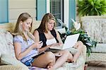 Teenage Girls Sitting on Front Porch Using Laptop Computer and Listening to mp3 Player Stock Photo - Premium Rights-Managed, Artist: Kevin Dodge, Code: 700-03596292