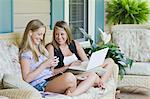 Teenage Girls Sitting on Front Porch Using Laptop Computer and Listening to mp3 Player Stock Photo - Premium Rights-Managed, Artist: Kevin Dodge, Code: 700-03596293