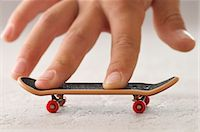 preteens fingering - Boy's Hand with Toy Skateboard Stock Photo - Premium Rights-Managednull, Code: 700-03601359