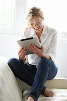 Woman Using iPad Stock Photo - Premium Rights-Managednull, Code: 700-03601474