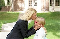 Mother Kissing Daughter in front of School Stock Photo - Premium Rights-Managednull, Code: 700-03601495