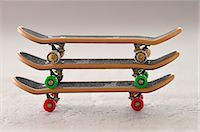 Three Toy Skateboards Stacked Stock Photo - Premium Rights-Managednull, Code: 700-03601510