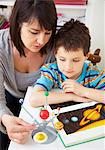 Woman and Young Boy Inspecting Solar System Model Stock Photo - Premium Rights-Managed, Artist: ableimages, Code: 822-03601541