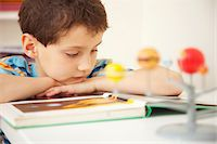 pre-teen boy models - Boy Reading Book Stock Photo - Premium Rights-Managednull, Code: 822-03601671