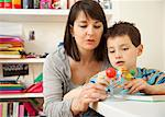 Woman and Young Boy Inspecting Solar System Model Stock Photo - Premium Rights-Managed, Artist: ableimages, Code: 822-03601768