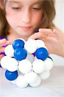 Girl Inspecting Atom Model Stock Photo - Premium Rights-Managednull, Code: 822-03602062