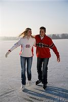 Couple ice skating together, front view Stock Photo - Premium Royalty-Freenull, Code: 618-03611003