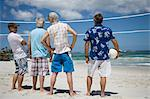 Mature men standing on beach looking at volleyball net, rear view Stock Photo - Premium Royalty-Free, Artist: Steve Prezant, Code: 618-03611069