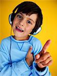 Kid With headphones Stock Photo - Premium Royalty-Freenull, Code: 618-03611517