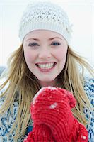 A portrait of a young woman wearing a woolen hat and red gloves Stock Photo - Premium Royalty-Freenull, Code: 618-03612579