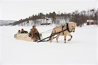 A horse pulling a sleigh full of people through the snow Stock Photo - Premium Royalty-Freenull, Code: 618-03612662