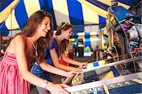pinball - Two Young Women Playing Arcade Games Stock Photo - Premium Rights-Managednull, Code: 700-03613042