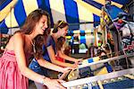 Two Young Women Playing Arcade Games Stock Photo - Premium Rights-Managed, Artist: Ty Milford, Code: 700-03613042