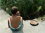 Little Boy With Cake, Province of La Spezia, Liguria, Italy Stock Photo - Premium Rights-Managed, Artist: Svenja Kaufmann, Code: 700-03615915