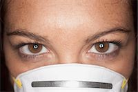 Close-up of Woman Wearing a Face Mask Stock Photo - Premium Royalty-Freenull, Code: 600-03616054