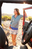 Woman Standing by 4x4 Vehicle in the Desert at Sunset, Near Cabo Pulmo, Baja California Sur, Mexico Stock Photo - Premium Rights-Managednull, Code: 700-03616021