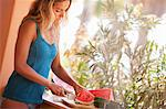 Woman Slicing Watermelon, Near Cabo Pulmo, Baja California Sur, Mexico Stock Photo - Premium Rights-Managed, Artist: Ty Milford, Code: 700-03616030