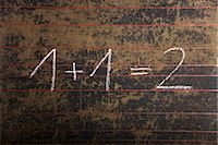 Equation on a black board Stock Photo - Premium Rights-Managednull, Code: 853-03616781