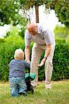 Grandfather and toddler with doll's pram outdoors Stock Photo - Premium Rights-Managed, Artist: F1Online, Code: 853-03616914