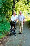 Grandparents going for a walk with grandson in pushchair Stock Photo - Premium Rights-Managed, Artist: F1Online, Code: 853-03617033