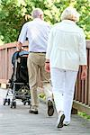 Grandparents going for a walk with grandson in pushchair Stock Photo - Premium Rights-Managed, Artist: F1Online, Code: 853-03617039