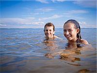 Boy and Girl Swimming, Lake Wanapitei, Sudbury, Ontario, Canada Stock Photo - Premium Royalty-Freenull, Code: 600-03621294