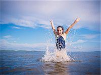 Girl Playing, Lake Wanapitei, Sudbury, Ontario, Canada Stock Photo - Premium Royalty-Freenull, Code: 600-03621296