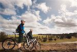 Couple mountain biking in countryside Stock Photo - Premium Royalty-Free, Artist: Cultura RM, Code: 649-03621799