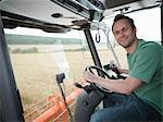 Farmer driving combine harvester Stock Photo - Premium Royalty-Free, Artist: Cultura RM, Code: 649-03622437