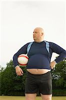 fat man balls - Large footballer Stock Photo - Premium Royalty-Freenull, Code: 649-03622517