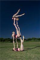 Acrobatic troop performing moves Stock Photo - Premium Royalty-Freenull, Code: 649-03622538