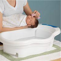 Mother Washing Newborn Baby Stock Photo - Premium Royalty-Freenull, Code: 600-03623036