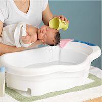 Mother Washing Newborn Baby Stock Photo - Premium Royalty-Freenull, Code: 600-03623037