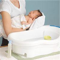 Mother Washing Newborn Baby Stock Photo - Premium Royalty-Freenull, Code: 600-03623038